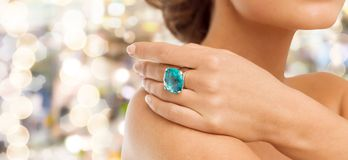 Closeup of woman hand with big blue cocktail ring Royalty Free Stock Photos