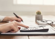 Closeup of woman hand counting on calculator Stock Photography
