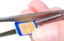 Micro SIM card is tailored to a nano SIM stock photography