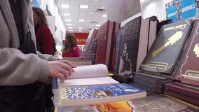 Closeup woman hand going to flip page of book stock footage