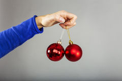 Closeup of woman hand holding christmas balls Royalty Free Stock Photo
