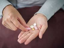 Closeup woman hand holding a pill. Healthcare, medical supplements concept Royalty Free Stock Images
