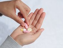 Closeup woman hand holding a pill. Healthcare, medical supplements concept Royalty Free Stock Image