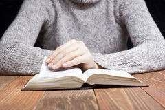 Closeup woman hand  holding pocket book to read Stock Photography