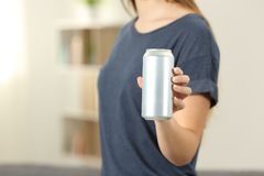 Closeup of a woman hand holding a soda drink can. At home Stock Images