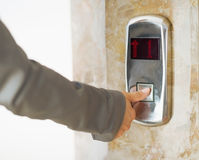 Closeup on woman hand pushing elevator button Royalty Free Stock Photo