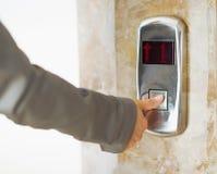 Closeup on woman hand pushing elevator button Royalty Free Stock Photo