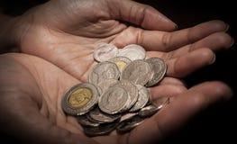 Closeup of Woman hand`s holding Thai coins. Woman hand`s holding Thai coins Royalty Free Stock Photography