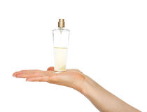 Closeup on woman hand showing perfume bottle Stock Image