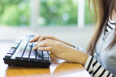 Closeup of a woman hands busy typing on a laptop Stock Photo