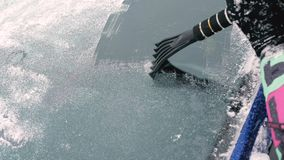 Cleaning Car Window With An Ice Scraper Stock Footage