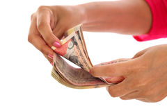 Closeup of woman hands counting money against white Royalty Free Stock Images