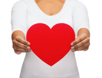 Closeup of woman hands with heart. Love and relationships concept - closeup of woman hands with heart Stock Images