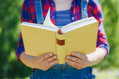 Closeup woman hands holding book to read Royalty Free Stock Images