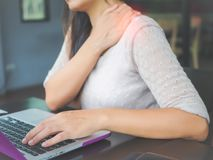 Closeup woman with hands holding her shoulder pain. stock photos