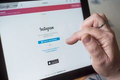 Closeup of woman hands on Instagram home page registration of web site on tablet. Mulhouse - France - 16 March 2018 - closeup of woman hands on Instagram home royalty free stock images