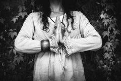 Closeup of woman hands in meditation yoga position. Outdoor in black and white stock photography