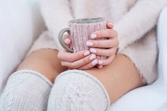 Closeup woman hands with pink manicure holding cup Stock Image