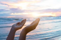 Closeup woman hands praying for blessing from god. During sunset background. Hope concept royalty free stock photo
