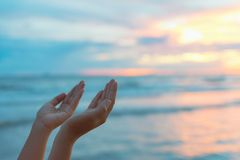 Closeup woman hands praying for blessing from god during sunset. Background. Hope concept royalty free stock images