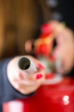 Closeup woman hands with red nailpolish showing how to operate fire extinguisher Royalty Free Stock Photography