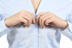 Closeup of a woman hands unbuttoning a shirt Stock Photos