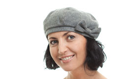 Closeup of woman in a hat, isolated. Mature brunette woman in a hat looking into camera, isolated on white background Stock Images