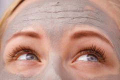Closeup of woman having grey mud mask on face Stock Image