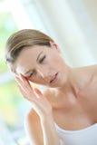 Closeup of a woman having a headache Stock Photos
