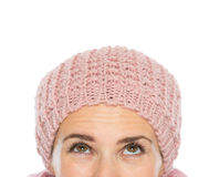 Closeup on woman head with knit hat looking up Stock Photos