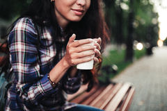 Closeup on a woman holding a cup of cofee Stock Photos