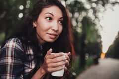 Closeup on a woman holding a cup of cofee Stock Images