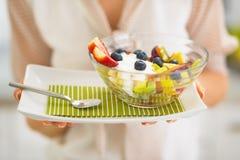 Closeup on woman holding fresh fruit salad Royalty Free Stock Photography