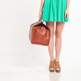 Closeup woman holding hand luggage, weight and baggage dimensions Royalty Free Stock Photos