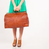 Closeup woman holding hand luggage, weight and baggage dimensions Royalty Free Stock Photography
