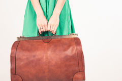 Closeup woman holding hand luggage, weight and baggage dimensions Stock Photography