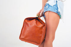Closeup woman holding hand luggage, weight and baggage dimensions Royalty Free Stock Photo