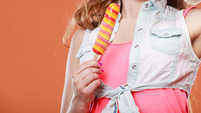 Closeup of woman holding ice cream popsicle. Royalty Free Stock Image