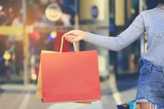 Closeup of woman holding shopping bags with standing at the department store stock image