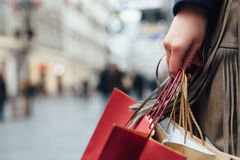 Closeup of woman holding shopping bags Royalty Free Stock Photography