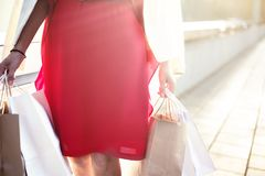 Closeup of woman holding shopping bags on the street with copy space Stock Photos