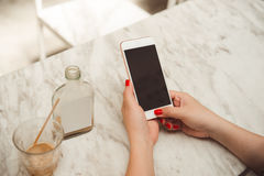 Closeup of woman holding and showing screen of her smartphone Royalty Free Stock Photography