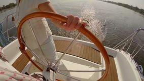 Closeup woman holding steering wheel on yacht. Summer, vacation. Stock footage stock video