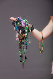 Closeup of woman with jewelry necklaces beads. Stock Image