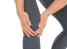 Closeup on woman with knee pain Stock Photography
