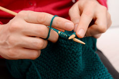 Closeup of woman knitting with teal wool Stock Photography