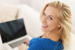 Closeup of woman with laptop Stock Photography
