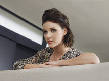 Closeup Of Woman Leaning On Couch Royalty Free Stock Image