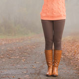 Closeup of woman legs in brown boots. Fall fashion. Closeup of woman legs in brown boots. Girl in autumn park forest. Fall winter fashion Stock Photos