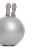 Closeup on woman legs on fitness ball Stock Photography